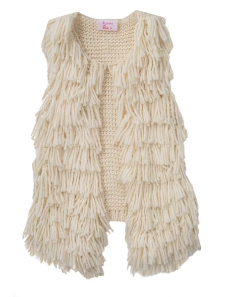This knit vest features a tassel front, and is perfect to layer over tops and dresses.