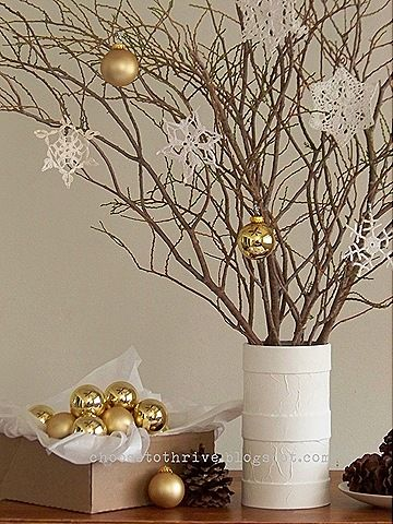 "branches in vase, can change out ""ornaments"" for year round decor"