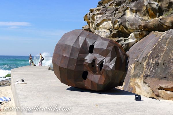 Giant baby head sculpture at Bondi Beach, Australia
