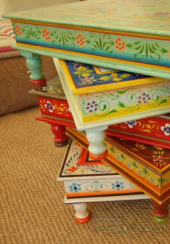 painted tables - for a more understated look, paint designs around the edge and keep the top plain. Folk It designs would be perfect for this