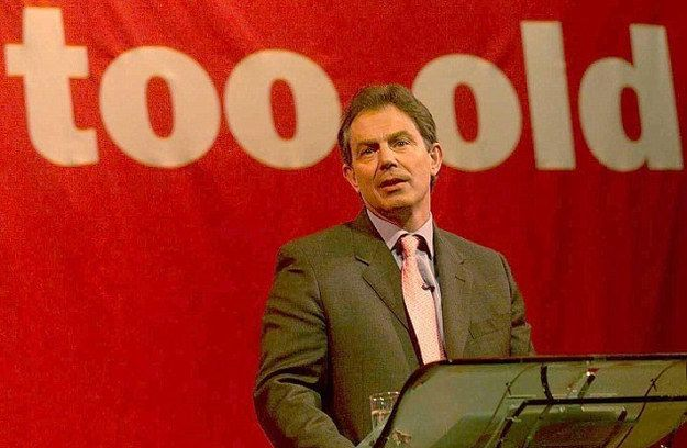 Poor Tony Blair, he really wasn't that long in the tooth.   13 Incredibly Awkward Pictures Of Politicians Standing In Front Of Unfortunate Signs