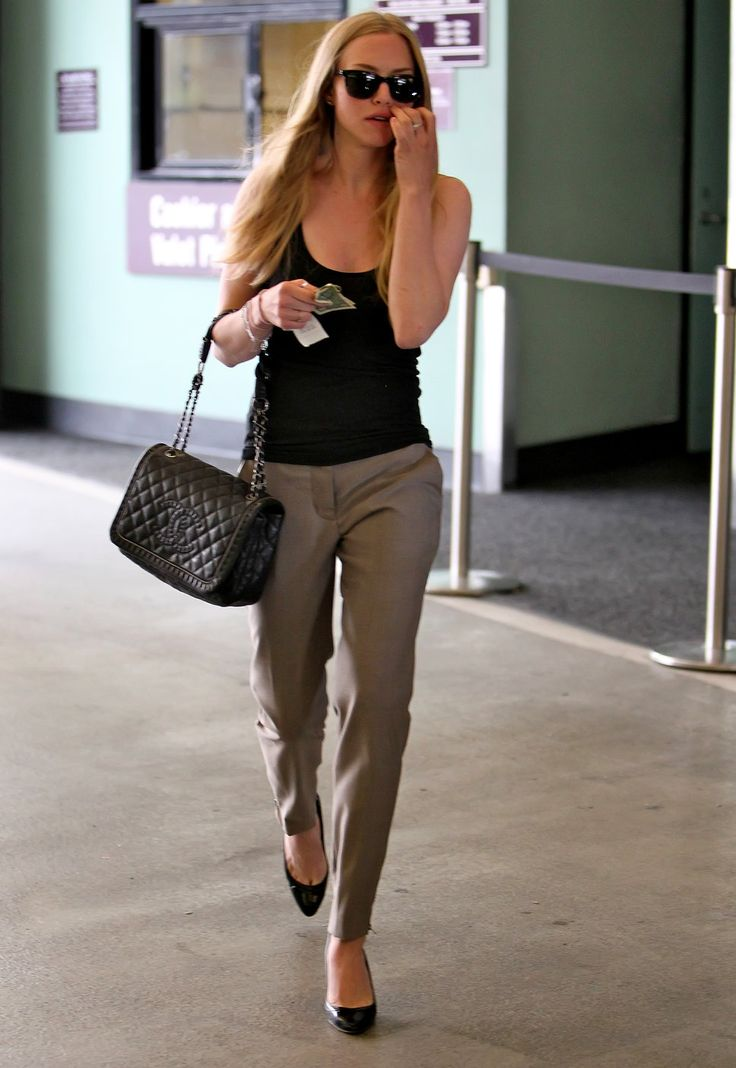 Amanda Seyfried chanel bag black tanktop menswear pants black heels