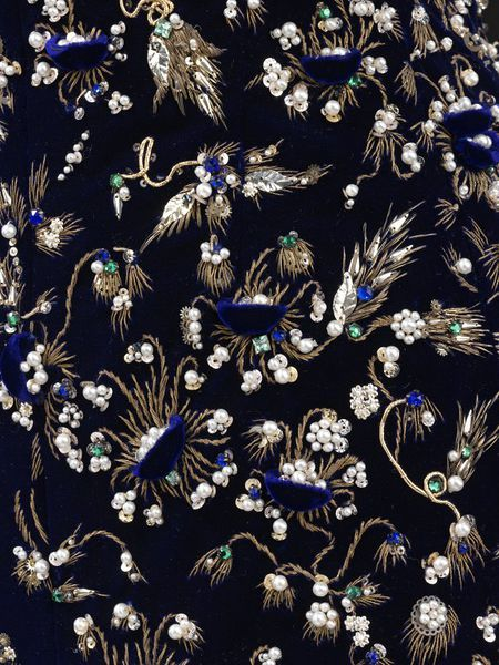 Christian Dior couture dress 1956 evening short strapless midnight blue velvet with embroidery of gold thread, sequins, pearls, green, blue pastes in design of sprays and tendrils springing from nests of pearls in velvet by Rébé.