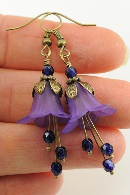 Dangle Earrings. Matte vineyard purple lucite flowers are topped with antique brass bead caps and plum faceted Czech beads. Dangling below are plum faceted Czech round beads again, adding drama to the flowers and making the stamens. And still very light weight!  Total length: 1 2/3 inches (42mm) from the bottom of the antique brass french hooks, or 2 2/5 inches (60mm) from the tops of the earwires. Please see the earrings on the real size mannequin or my hands for a better idea.  If you…