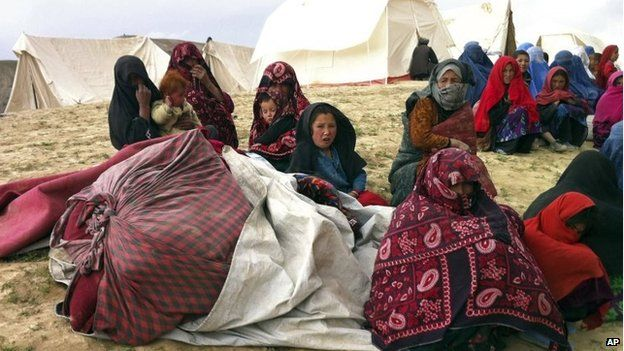 Survivors sit with their possessions near the site of Friday's landslide that buried Ab Barik village in Badakhshan province, north-eastern Afghanistan, 3 May 2014