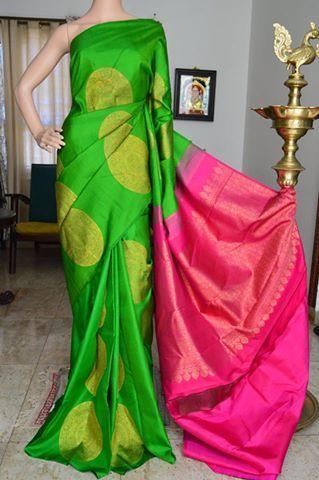 Green pure silk pure zari kanchivaram silk saree with big circle zari butta on full body and pink zari rich pallu. Code: A0817KA021709 Cost: 15500 inr