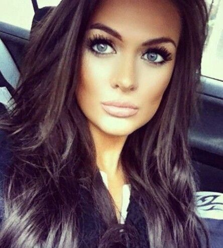 Brunette hair, blue eyes