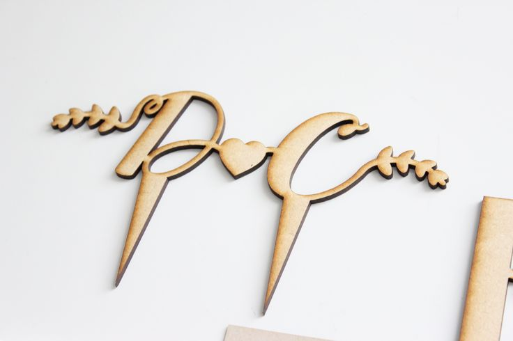 Wooden cake topper created by Secret Diary. #caketopper #weddingstationery