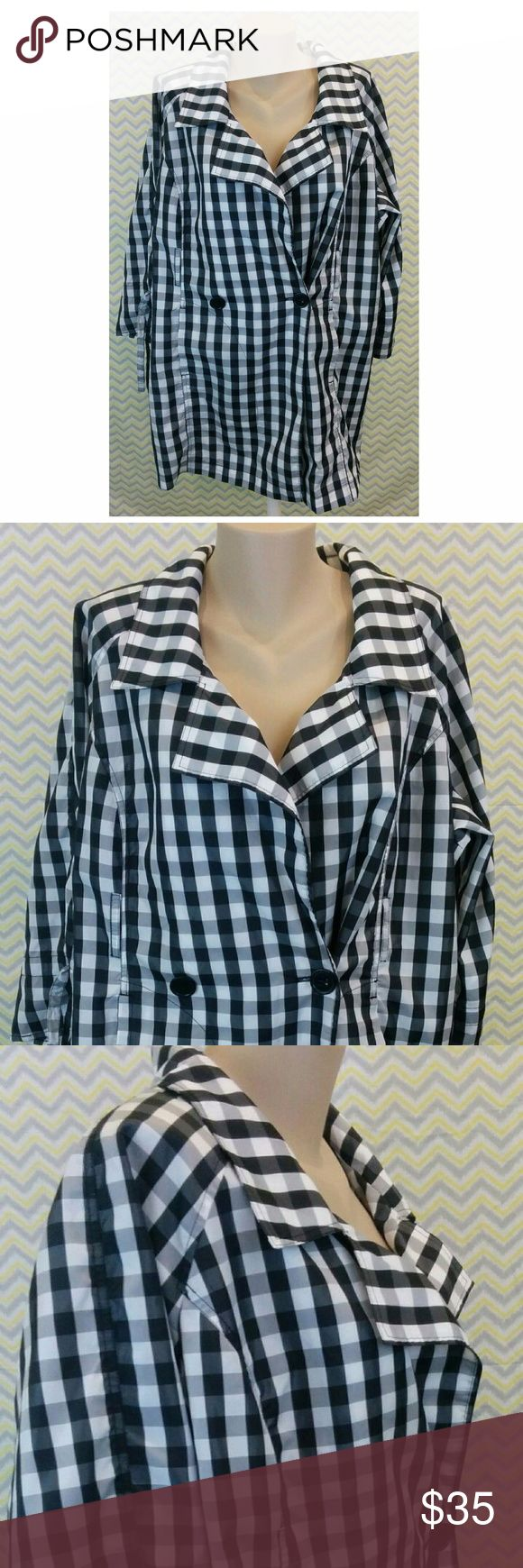 Checkered Rain Coat Button Close Jacket Plaid B/W Brand: Lane Bryant Size: 18/20 Item: Women's Plus Size 1 Button Checkered Rain Jacket Color: Black & White Jacket has belt loops, no belt included  Dimensions: Chest from seam under armpit to seam under armpit- approximately 24 inches Sleeve length from shoulder seam to bottom of sleeve- approximately 24 inches Length from top of shoulder to bottom of jacket - approximately 33 inches  Inventory -  R18 Lane Bryant Jackets & Coats Trench Coats