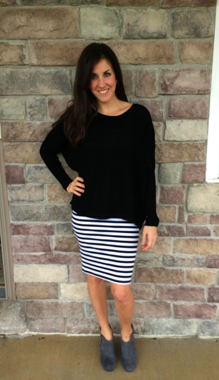 Black and White Striped Skirt with and oversized black and white sweater and grey ankle booties outfit