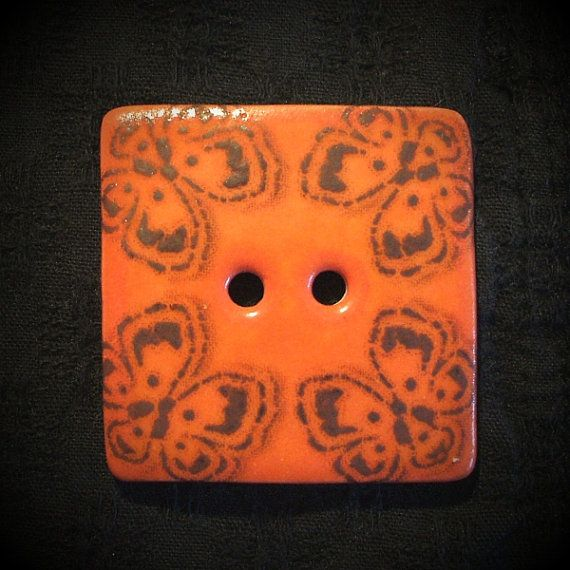 My original butterfly motif on red-orange. Translucent porcelain.