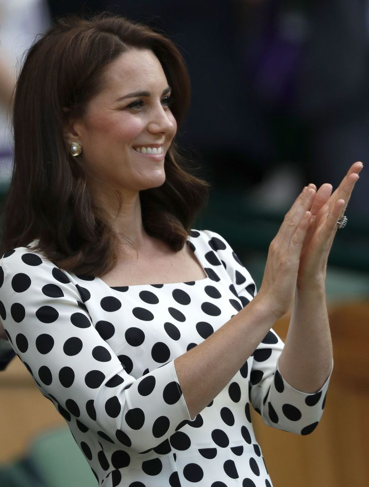 Britain's Catherine, Duchess of Cambridge applauds after Czech Republic's Petra Kvitova won against Sweden's Johanna Larsson during their women's singles first round match on the first day of the 2017 Wimbledon Championships at The All England Lawn Tennis Club in Wimbledon, southwest London, on July 3, 2017.Kvitova won the match 6-4, 6-4. / AFP PHOTO / Adrian DENNIS / RESTRICTED TO EDITORIAL USE (Photo credit should read ADRIAN DENNIS/AFP/Getty Images) via @AOL_Lifestyle Read more: https: