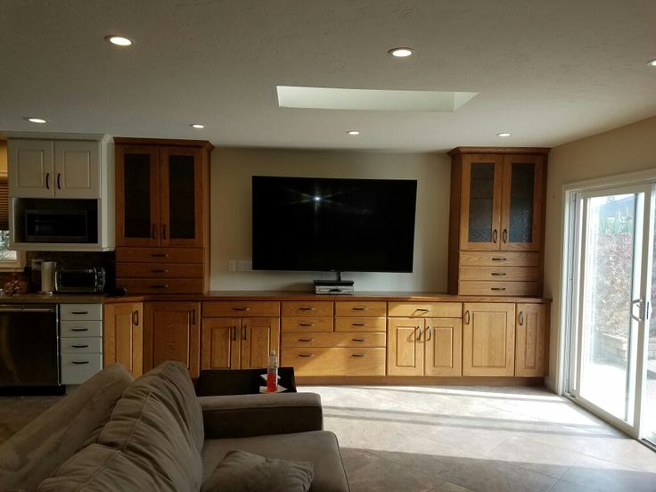 Entertainment center with 75 inch TV mounted on wall