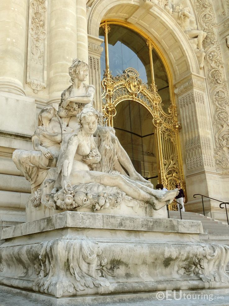 This is a photo of the Petit Palais' detailed and extravagant entrance with gold wrought iron gates and carved stone statues as well on display.  See more Paris Photos at http://www.eutouring.com/