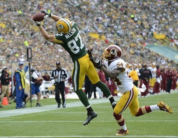 Green Bay Packers receiver Jordy Nelson makes a catch past Washington Redskins safety Bacarri Rambo (24) for a 15-yard touchdown in the third quarter during Sunday's game at Lambeau Field. Evan Siegle/Press-Gazette Media