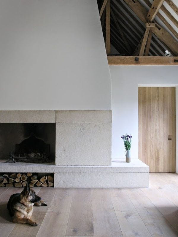 wide plank wood floor, plaster fireplace
