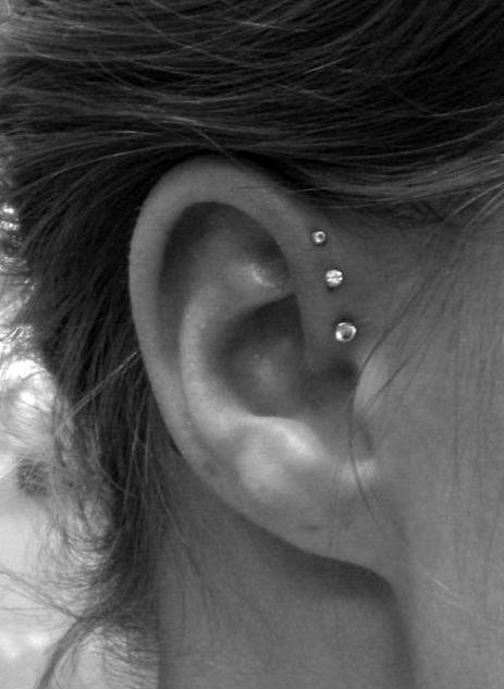 Love the forward helix piercings.