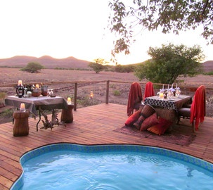 Dinner by the pool, Desert Rhino Camp, Palmwag Concession, Namibia