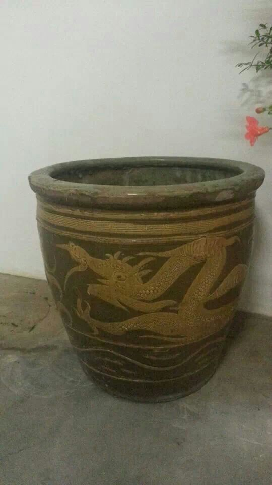 A vintage dragon pot...every Peranakan home had one or two...one in the bathroom + one in the kitchen.