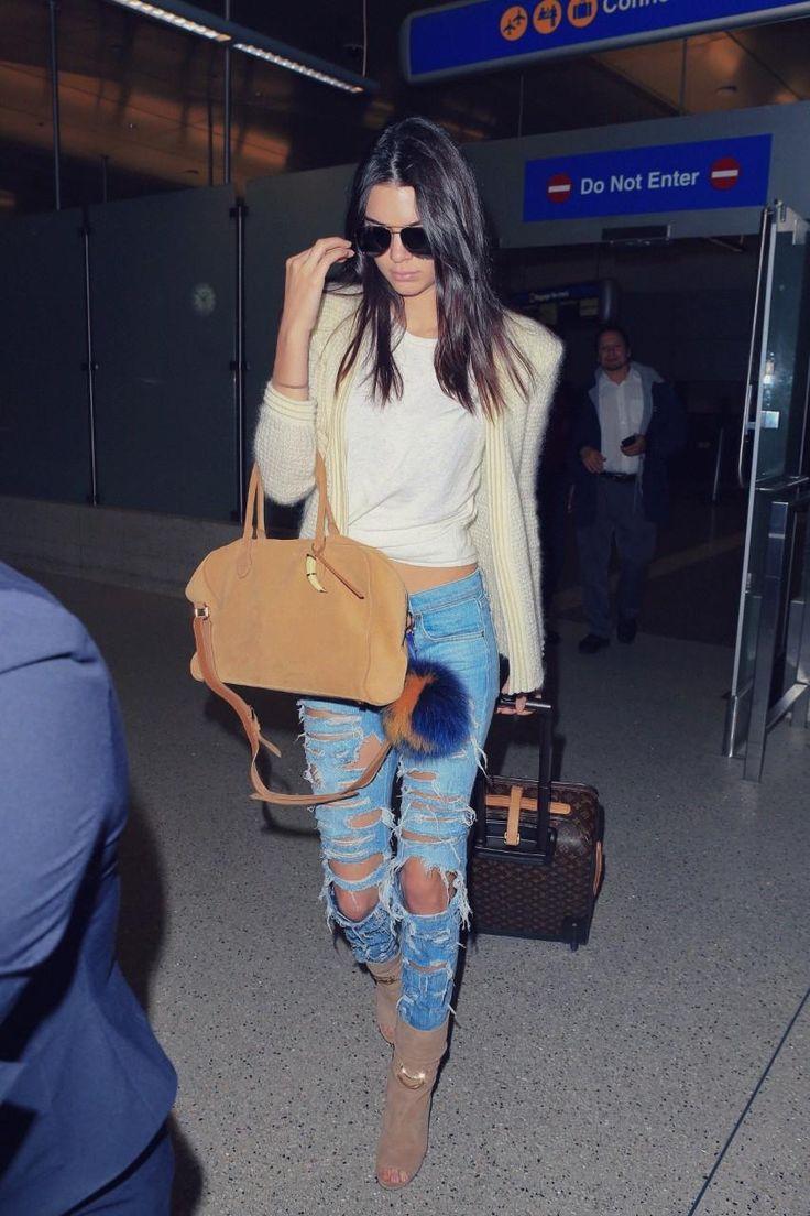 Kendall Jenner wearing Louis Vuitton Monogram Canvas Pegase Suitcase, Rag & Bone the Dre Boyfriend Jeans in Thrasher, Jimmy Choo Mysen Suede Open-Toe Booties, Balmain Mohair-Blend Cardigan, Balmain Pierre Bag and Fendi Pon Pon Key Ring