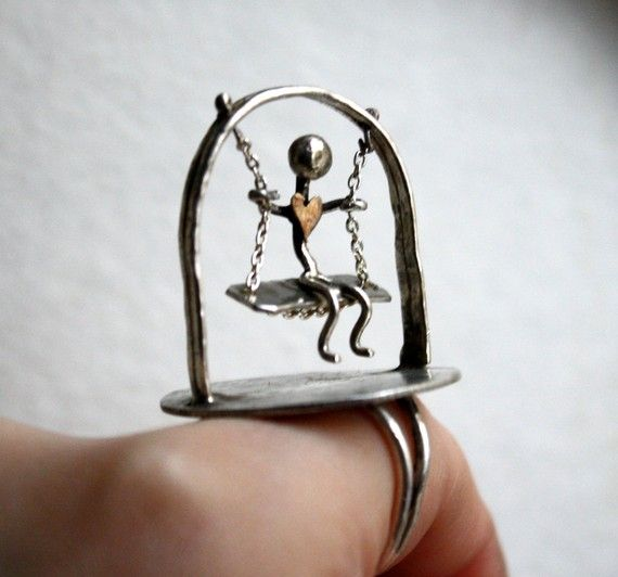 "Ring | Rachel Pfeffer.  ""Swinging Man II""  Silver and brass."