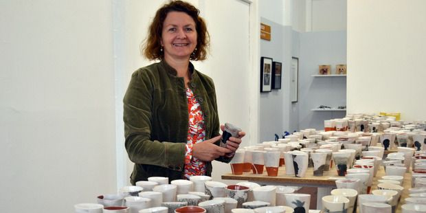 A CERAMICS RENAISSANCE: Leigh Anderton-Hall with her 1000 cups project. PICTURE / PAUL BROOKS