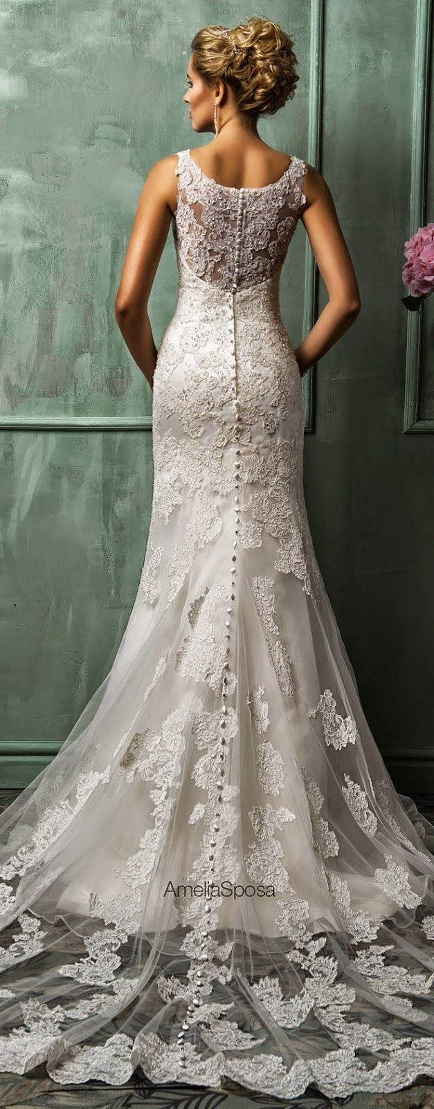 Best Wedding Dresses of 2014 - Belle The Magazine  What a beautiful dress to wear. With all that lace it is very feminine.
