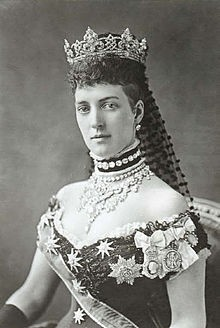 Alexandra of Denmark, the Queen Consort of Edward VII.  She nearly always wore a 'dog collar' choker necklace or a necklace on a band of velvet, as in this photo, to hide a scar on her neck. |Pinned from PinTo for iPad|