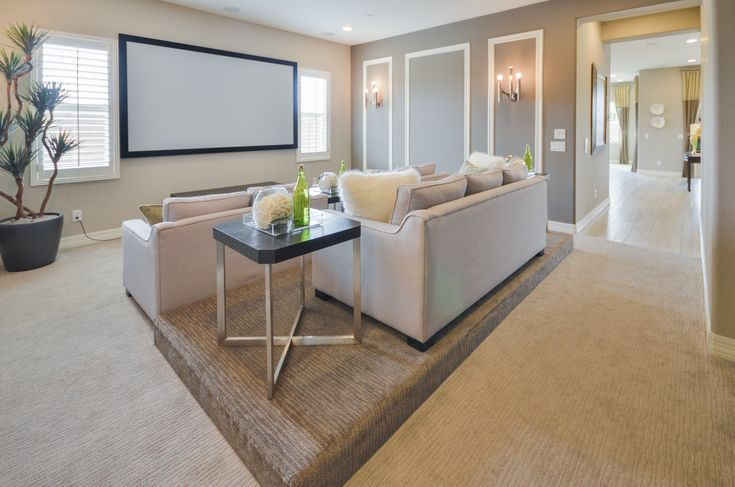 Home theater room in Taylor Morrison model home