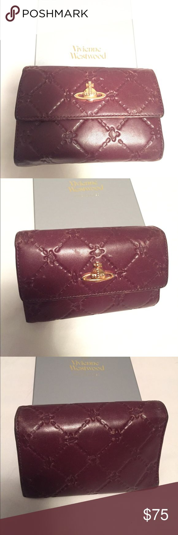 """Vivienne Westwood Wallet USED Vivienne Westwood leather tri-fold wallet with original box. Has lots of compartments for cards, cash, receipts, and coins. Snap closure.                              There are scratches, rips, and slight discoloration from wear and tear.                                                             Color: Bordeaux                                                Dimensions:  5.5"""" x 4"""" x 1.5"""" Vivienne Westwood Bags Wallets"""