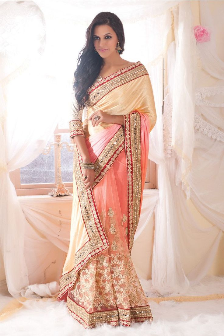 Buy Cream Net Designer Bollywood Saree Online in low price at Variation. Huge collection of Bollywood Sarees for Party, Festival and All celebrations. #party #bollywood #bollywoodsarees #sarees #onlineshopping #latest #lowprice #variation #modern #farewell. To see more - https://www.variationfashion.com/collections/bollywood-sarees.