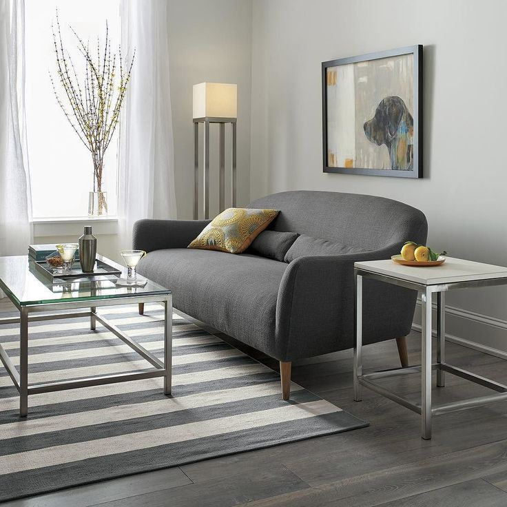 Era Rectangular Coffee Table. Era Limestone Side Table. Pennie Sofa Gracie Yellow Down Alternative 18x18 Pillow Piper Waiting Olin Grey Striped Cotton Rug. Aerin Brushed Nickel Floor Lamp.  apartment homedecor interiordesign Meet Pennie. Perfect for #apartment living. Click the link in our bio to shop! #HomeDecor #InteriorDesign