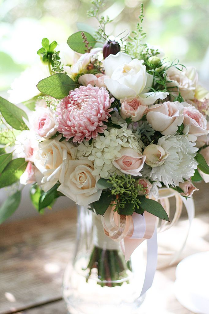 Pretty light pink and white bouquet of roses, mums, hydrangea and seeded eucalyptus.