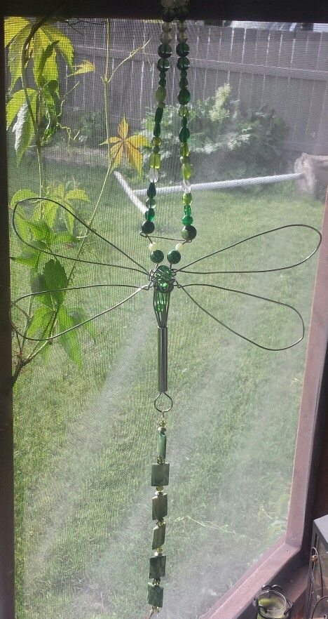 Dragonfly sun catcher I made from a wire whisk different beads and jewery
