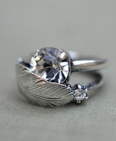 this is a really cool idea for a second ring that could go over the engagement ring.. like a leaf shape, covering half of the diamond..