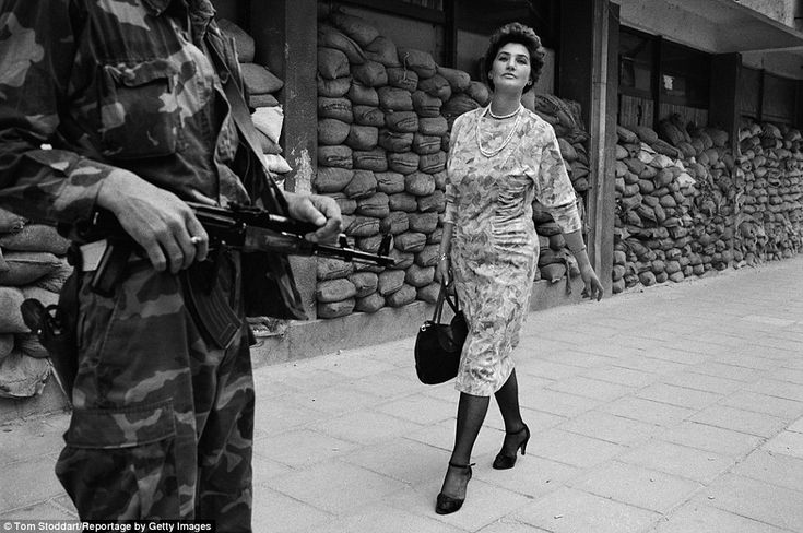 Meliha Vareshanovic walks proudly and defiantly to work in the dangerous suburb of Dobrinja during the siege of Sarajevo.  Tom Stoddart