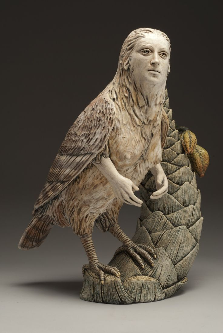 Siren with Palm, 2012, clay, glaze, wax encaustic, gold leaf, 18 x 13...