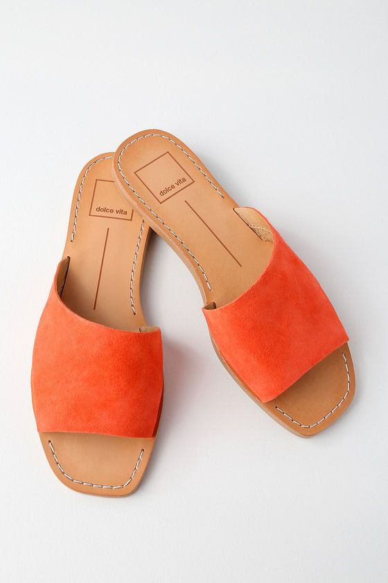 Kick-up your feet in style with the Dolce Vita Cato Orange Suede Leather Slide Sandals! These go-to slides feature a bold coral orange, genuine suede leather upper with a chic, angular design.