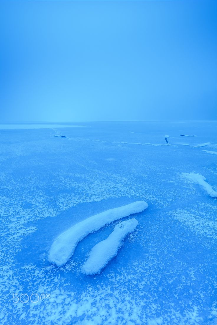 Endless horizon - Foggy scenery of nearby frozen lake in Bratislava-Petrzalka.