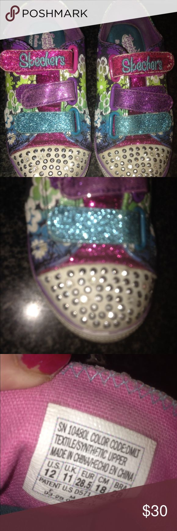 Kids Skechers that light up Twinkle Toes SZ 12 Adorable Skechers for kids called Twinkle Toes    When you walk, the silver buttons light up in bright blue and pink. Gently used lots of wear left. Velcro closures. Any girl would love these. Heck, I love these lol awesome sneakers for an awesome little one. Skechers Shoes Sneakers