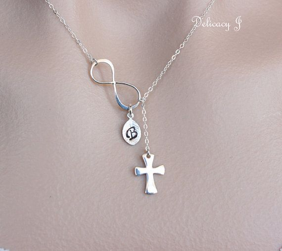 Cross Infinity Necklace, Sterling Silver Cross Necklace, Sideways Infinity and Cross, Infinity Cross, Figure Eight, Christmas gifts        This entire necklace is made of sterling silver.  - Infinity charm is 18mm x 8mm.  - Cross charm is 18mm long.  - This lariat necklace length is semi adjustable by pulling the cross up and down.    NECKLACE WITH INITIAL:  https://www.etsy.com/listing/127119100    ADD INITIAL LEAF CHARMS:  https://www.etsy.com/listing/43564578    ADD BIRTHSTONES…