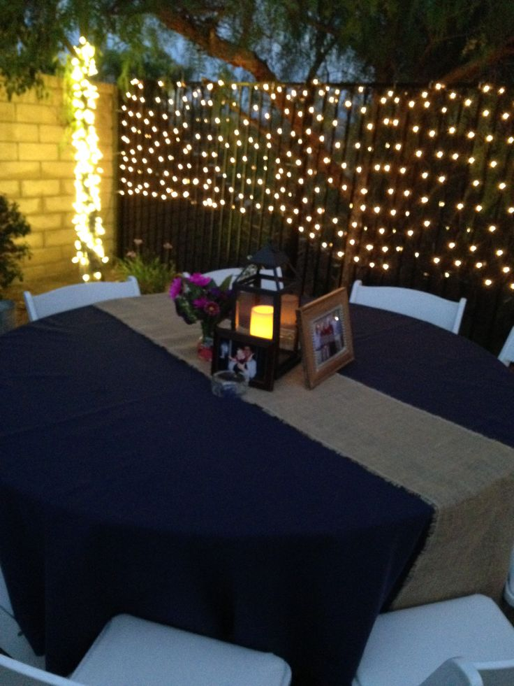 Out door table design. Burlap runner with lantern and picture frames #events #tabledesign