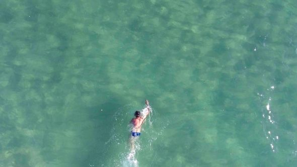 A Man Swims In The Sea. Aerial View From Copter #Background, #Beach, #Emevil, #Fish, #Fitness, #Man, #Nature, #Pattern, #Person, #Silhouette, #Spa, #Sport, #Summer, #Sun, #Texture, #Water http://goo.gl/J3hYjm