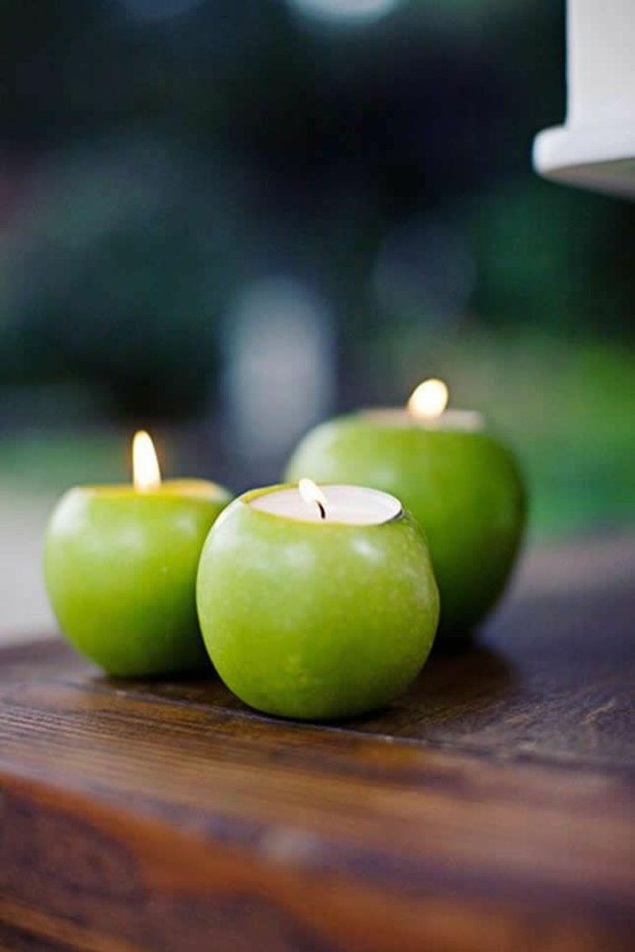 Décoration de table de mariage avec pommes et bougies