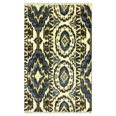 A bold ikat motif defines this eye-catching wool rug, artfully hand-knotted in Pakistan.    Product: RugConstruction Mat...