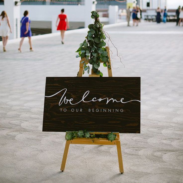 Make your welcome sign stand out with a combination of contemporary fonts and swirly type.     Photo via  The Style Co. .