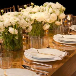 Simple glass table top and white flowers