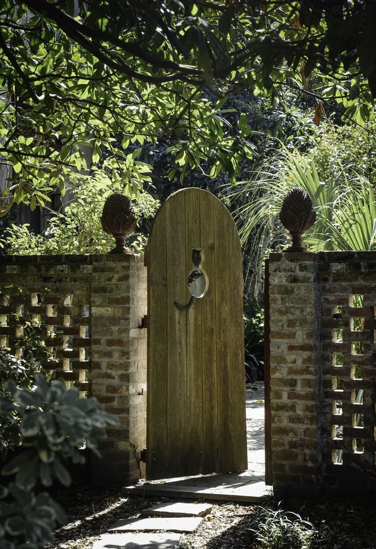 Nice brick wall letting light through and gate with finials.