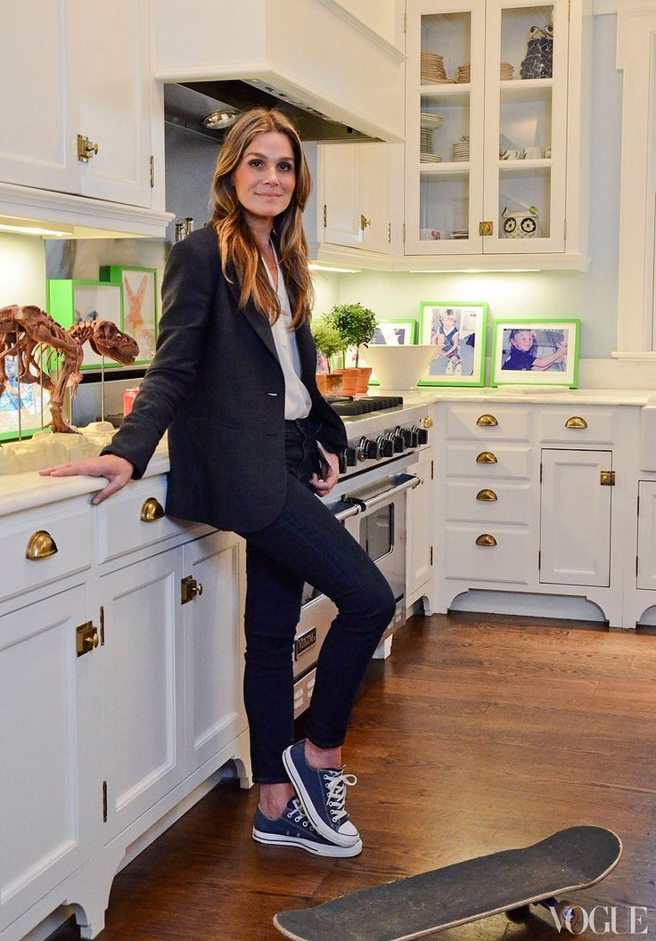 """Where the Heart Is - """"Our kitchen in the country is similar to our kitchen in New York. There are white cabinets, brass fixtures, elements of blue, and framed children's art in both spaces,"""" Lauder says. """"I have a formula for kitchens that always works for us."""""""