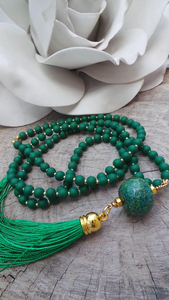 This necklace has lovely shades of green. As a colour, green is very relaxing and brings balance and harmony. D E T A I L S *Made with a gorgeous African turquoise gemstone as a focal bead *matte green glass beads interspersed with tiny gold Miyuki seed beads *and a green